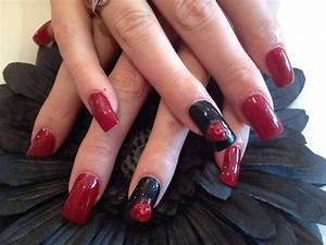 Acrylic nails with red and black polish and 3D flower ...
