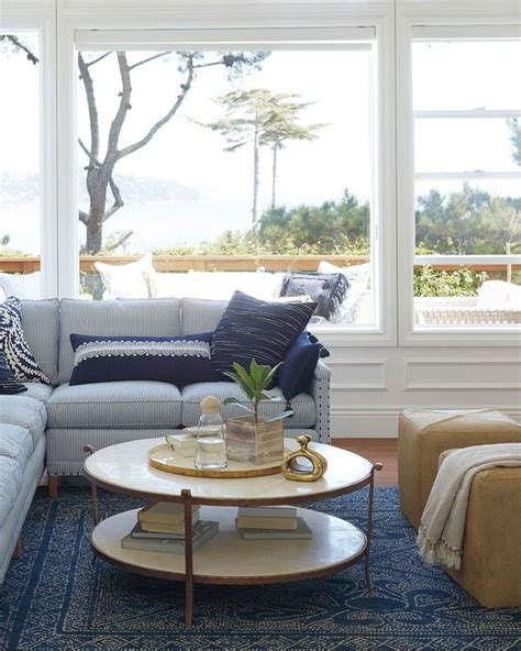 As the coffee table is the main focus there are some coastal themed coffee tables that you can make yourself. Serena & Lily St. Germain Round Coffee Table   Coastal living rooms, Stone coffee table, Blue ...