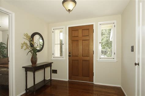 paint color acadia white walls are barely beige benjamin we this in our living room with acadia white trim
