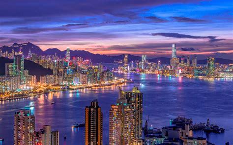 city skyline  wallpaper night life cityscape hong kong skyscrapers purple sky river