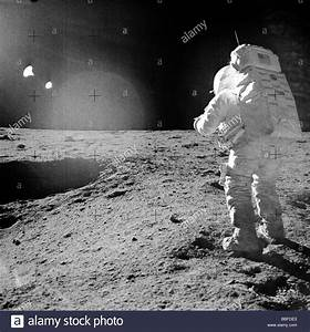 NASA astronaut exploring Moon surface photographed by ...