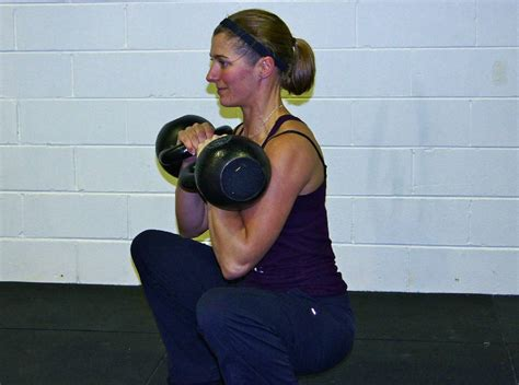 squat front kettlebell doing exercise kettlebells double squats re improve benefits strength crossfit 24kg james breakingmuscle workouts weightlifting breathing performance