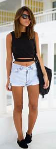 Picture Of bleached denim shorts, a black crop top and ...