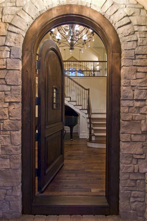 knotty alder doors Entry Rustic with arch doorway dark