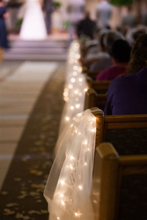 tulle  string lights aisle decorations