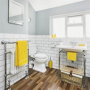 White And Grey Bathroom With Yellow Accents And Faux Wood