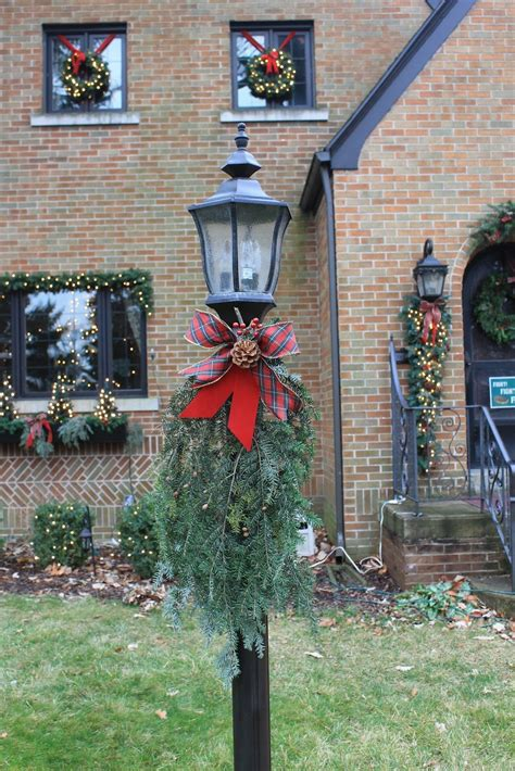 holiday lamp post    evergreen sprigs  ribbon