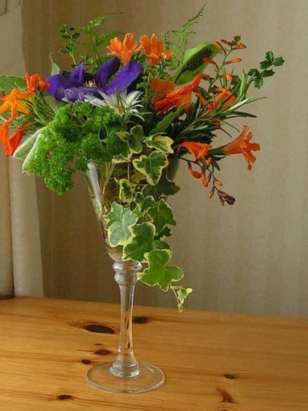 flower arrange  wine glass wedding centerpieces
