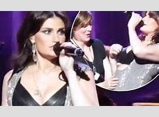 Idina Menzel recovers hilariously from cleavage wardrobe