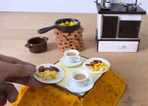 man cooks miniature breakfast  tiny kitchen set