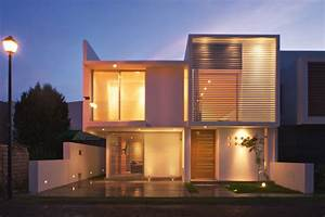 Front View House Exterior Among Modern Home Shaped Design