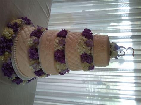 Fresh Purple And White Flowers With Ivory Wedding Cake