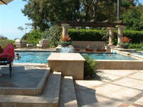 raised pool raised deck area and column travertine coping steps and decking pool is raised 18 pool