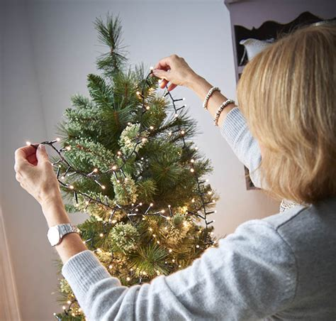 putting christmas lights on tree how to choose the best indoor lights wilkolife
