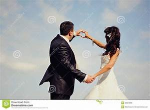 Groom And Bride Shows Symbol Of Heart Royalty Free Stock ...