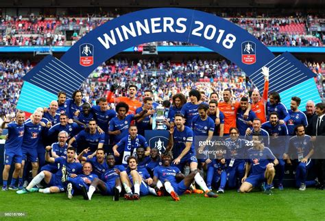 Chelsea players celebrate with the Emirates FA Cup Trophy ...