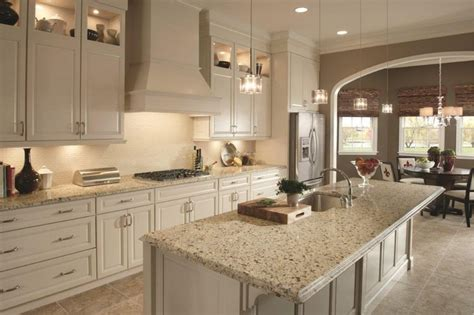 crema caramel granite countertops with backsplash