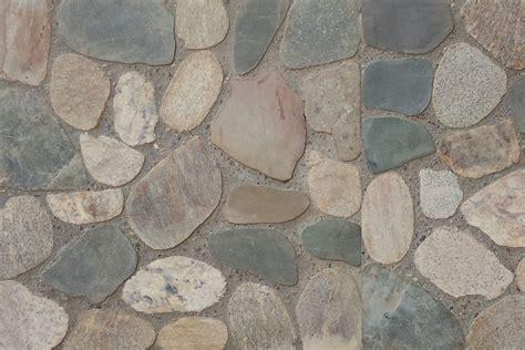 tile that looks like rock tgh pebble flooring paving