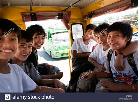 jeepney interior philippines filipino boys riding a jeepney on their way home from