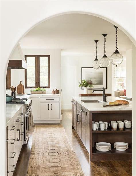 mediterranean kitchen with white cabinets white and brown mediterranean style kitchen