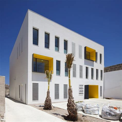 modern health center building  white  yellow