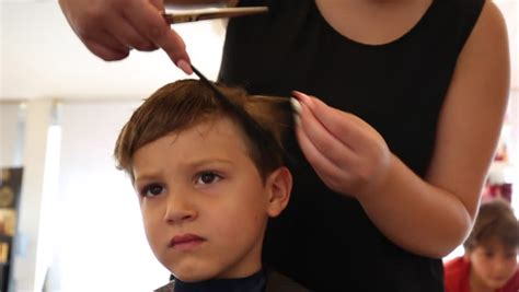 Boy Sings While Barber Cuts His Hair Cute Little Boy Is Singing While Barber Cuts His Hair. No Blonde Haircuts 2018 How To Give Yourself A Haircut Male Below The Shoulder Professional Machine Places In Bloomington Stupid Mens Shaved Sides Spikey Top Modesto Ca