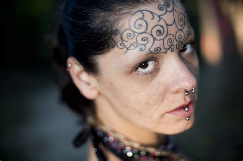 Face Tattoo Designs For 2015