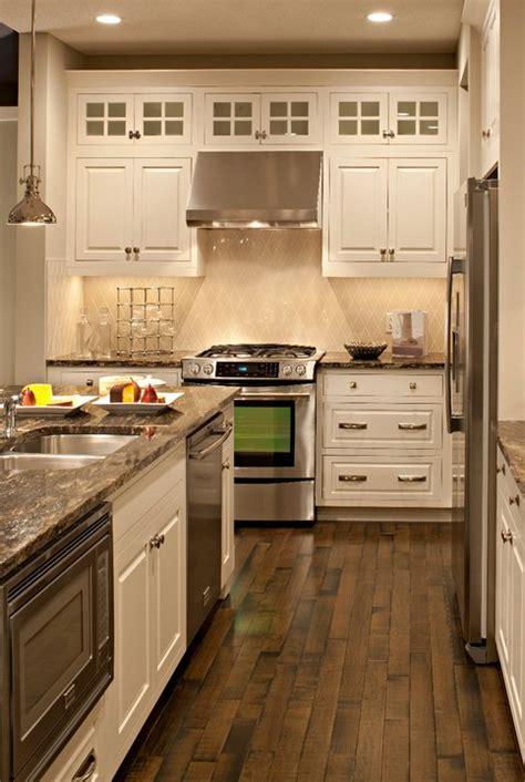 ivory kitchen cabinets  gray granite countertops