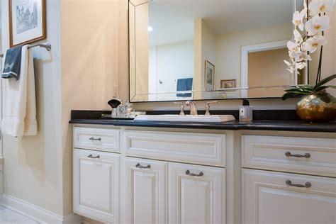 white cabinets  black granite countertops   bathroom