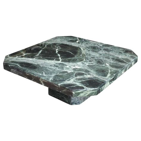 The top consists of a single slab of marmo verde alpi which offers a striking veined pattern. Modern Square Italian Green Marble Pedestal Coffee Table at 1stdibs