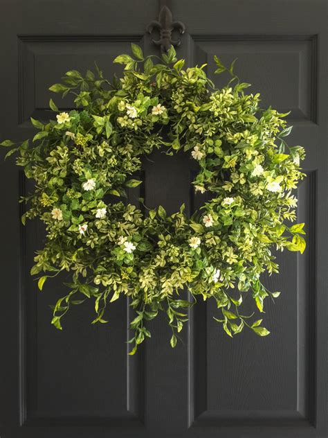 front door wreath boxwood wreath with white tea leaf flowers display wreath