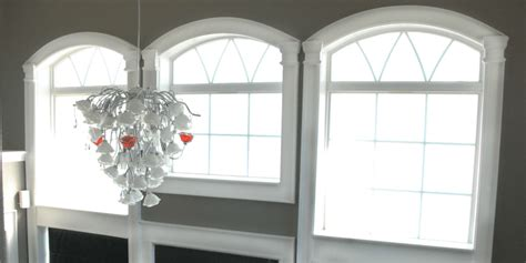 remodelaholic   install molding  trim  arched windows