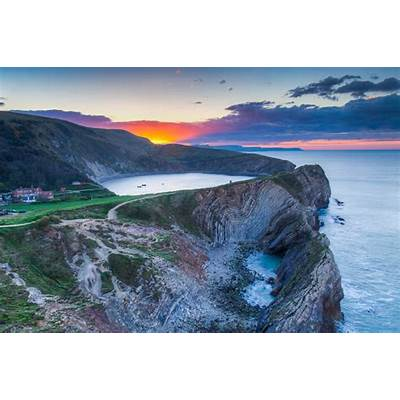 Sunrise Over Lulworth Cove by Tim JacksonTim Jackson