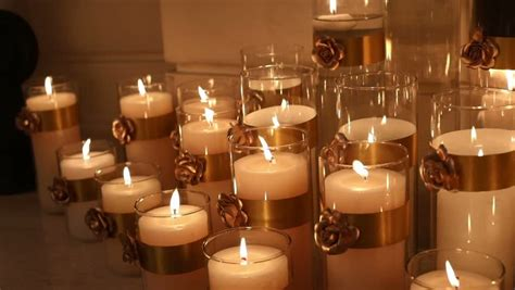 Many Candles Burning, Decorative Candle In A Glass Candlestick, Large Wax Candles Are Lit In The