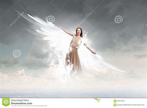 angel girl flying high stock photo image  angelic