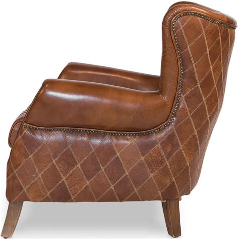 brown arm chair in leather