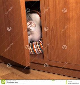 Scared child hiding stock image. Image of person, fear ...