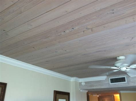 wood ceiling and white crown molding the of the