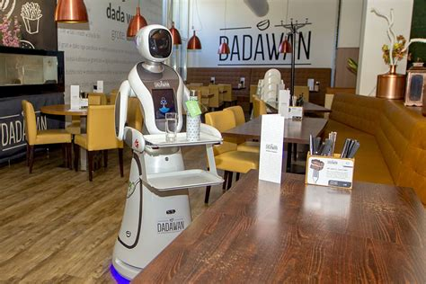 Robot waiters serve drinks and take temperatures at this ...