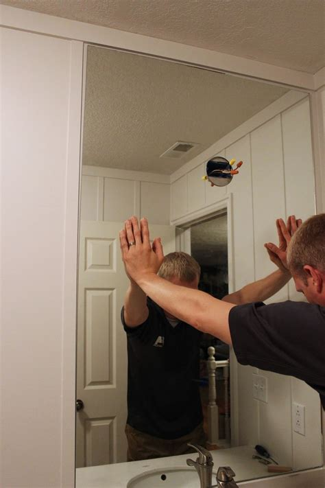 How To Install A Bathroom Mirror by How To Professionally Install A Bathroom Mirror
