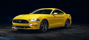2018-Ford-Mustang-Triple-Yellow-front-side-view_o - Kovatch Ford