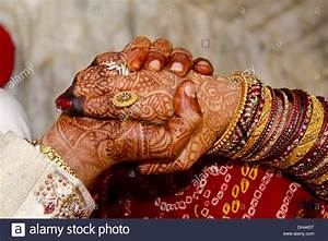 Indian wedding ceremony Bride and Bridegroom holding hands ...