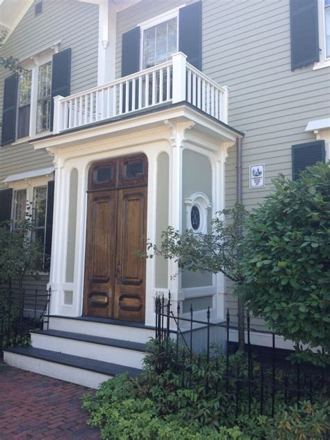 classic enclosed small front porch  top railing  beautiful wood double doors uploaded