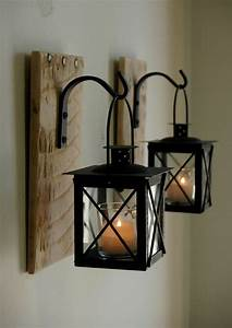 Black lantern pair with wrought iron hooks on recycled