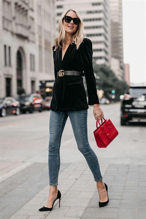 blonde woman wearing black velvet blazer gucci marmont
