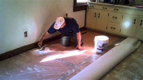Laying Vinyl Tile Linoleum by How To Cut In And Install A Vinyl Floor