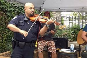 Policeman on the fiddle: Incredible moment cop steps on ...