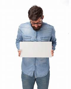 Young man holding a blank poster PSD file | Free Download