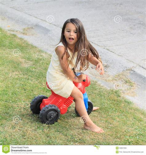 Little Girl Driving Barefoot