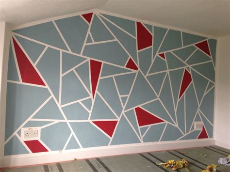painting geometric shapes on walls diy geometric feature wall frog tape and dulux roasted red and blue reflection home is where